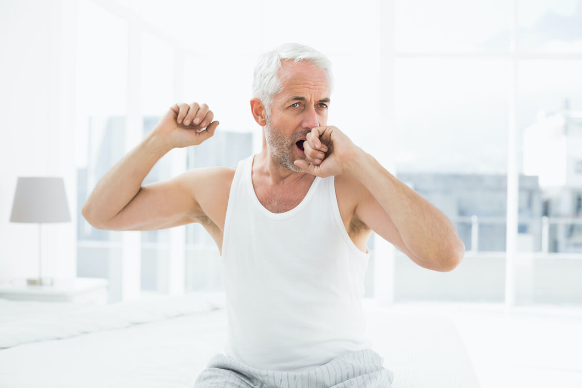 mature guy can't finish his yawn to completion because something caught his eye